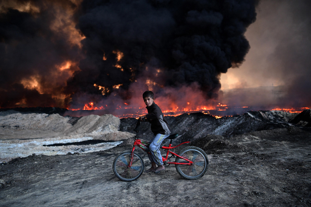 Boy and Burning Oil Field fine art photography