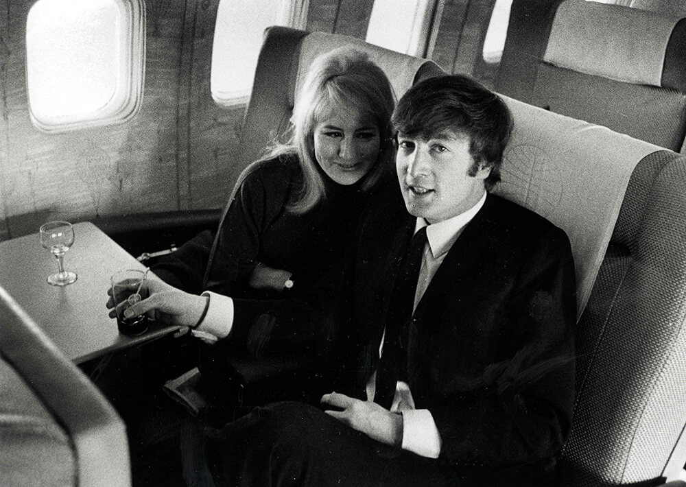 Volume 2, Page 84, Picture 6. The Beatles, February 1964. John Lennon with his wife Cynthia, flying to New York. from Beatles fine art photography